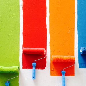 Green, red, orange and blue paint on wall